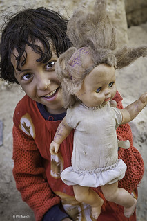 poor street urchin and her doll - Yemen