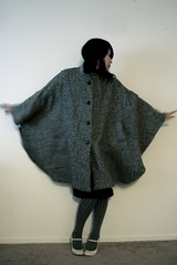 wool(0.0), costume(0.0), sweater(0.0), textile(1.0), clothing(1.0), outerwear(1.0), poncho(1.0), fashion(1.0),