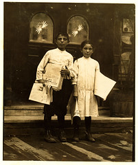 Lewis Hine: Newsgirl & boy selling around saloon entrances, Bowery, New York, 1910