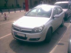 sedan(0.0), automobile(1.0), automotive exterior(1.0), opel(1.0), family car(1.0), vehicle(1.0), compact car(1.0), bumper(1.0), land vehicle(1.0),