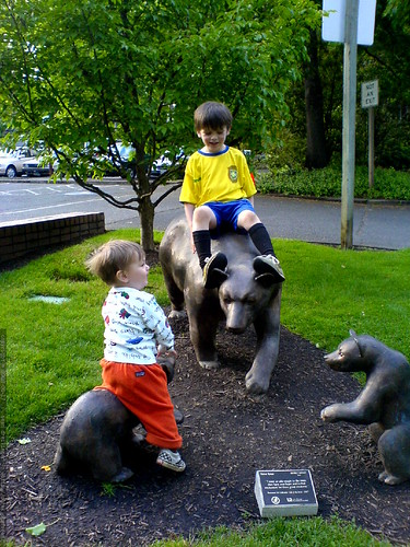 brothers abusing the bear sculpture outside our public library   DSC00908