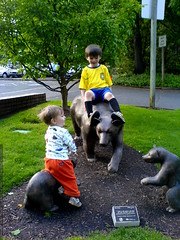 brothers abusing the bear sculpture outside our publ…