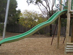 play(0.0), recreation(0.0), outdoor recreation(0.0), swing(0.0), outdoor play equipment(1.0), playground slide(1.0), city(1.0), public space(1.0), playground(1.0),