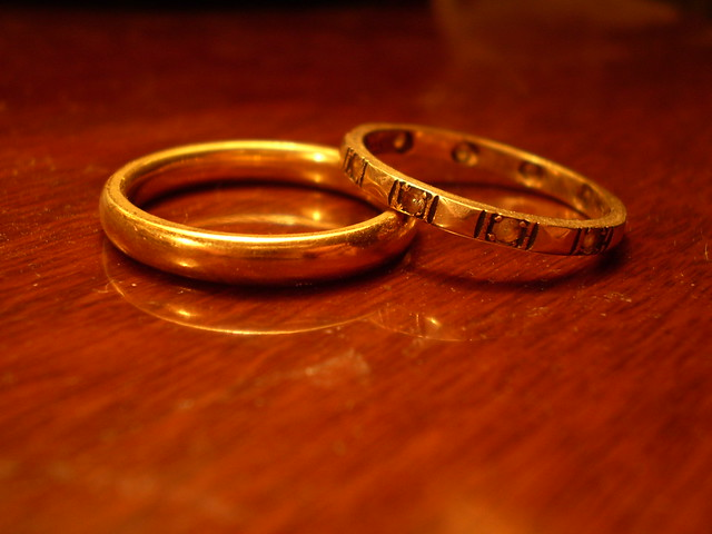 Two gold rings on table. (Photo: Les Chatfield)