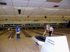 Aidan and Zoe bowl together.