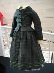 wool(0.0), kilt(0.0), overcoat(0.0), coat(0.0), pattern(1.0), textile(1.0), clothing(1.0), sleeve(1.0), outerwear(1.0), design(1.0), tartan(1.0), plaid(1.0),