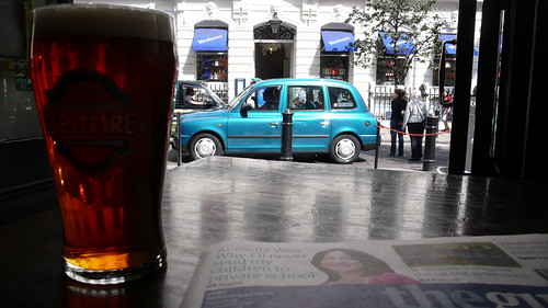 Like a British postcard - a pint, taxi and The Guardian