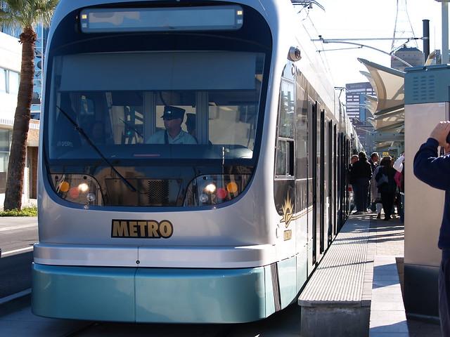 Valley metro light rail passengers board a westbound light