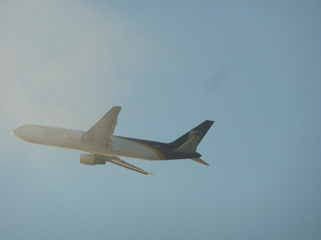 UPS Boeing 767-34AF(ER) cargo jet  N-315UP climbing into the clouds above LAX