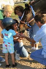 Olivia Feeding the Horse