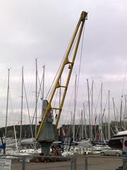 crane vessel (floating)(0.0), dock(0.0), construction equipment(0.0), cable-stayed bridge(0.0), port(1.0), vehicle(1.0), mast(1.0), marina(1.0), boat(1.0),