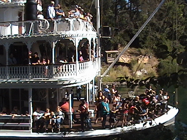 Mine Train thru Nature's Wonderland wreck display on the Rivers of America as the S.S. Mark Twain sternwheel packet steamer passes by, 2008.10.24