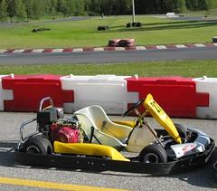 auto racing(0.0), automobile(0.0), race(0.0), open-wheel car(0.0), formula racing(0.0), formula one(0.0), formula one car(0.0), sports car(0.0), go-kart(1.0), kart racing(1.0), racing(1.0), sport venue(1.0), vehicle(1.0), sports(1.0), motorsport(1.0), race track(1.0),