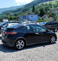 sedan(0.0), automobile(1.0), automotive exterior(1.0), family car(1.0), wheel(1.0), vehicle(1.0), automotive design(1.0), rim(1.0), honda civic type r(1.0), compact car(1.0), bumper(1.0), land vehicle(1.0), sports car(1.0),