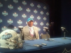 Cam Newton at The NFL Draft with the weight of the World off his shoulders.  Or is it?