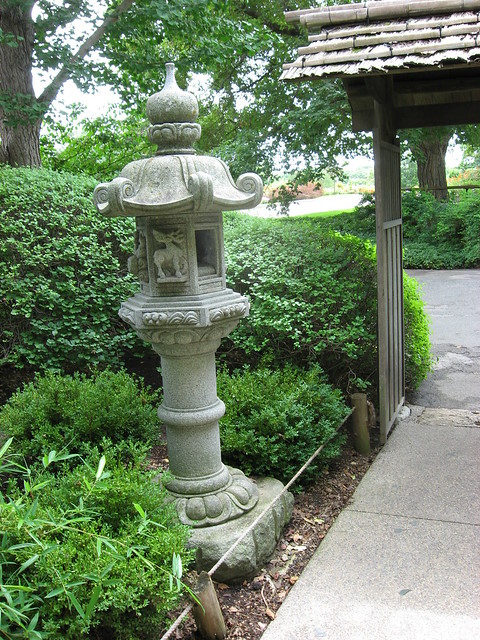 Stone lantern at the entrance to the japanese garden for Japanese garden entrance