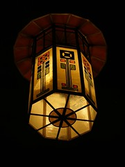 art, symmetry, light fixture, yellow, light, glass, design, circle, darkness, lantern, lighting, stained glass,