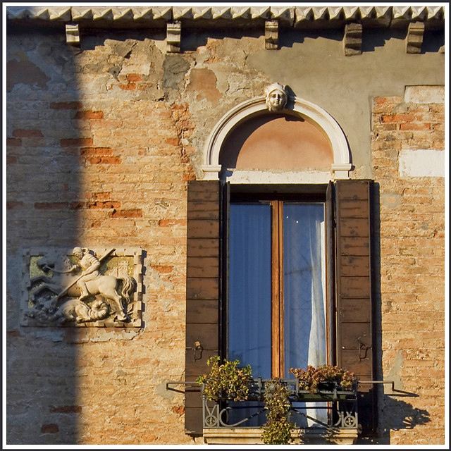 Rita Crane Photography:  Italy / Venice / architecture / shutters / bricks / bas relief / Window Catching the Sunshine, Venice