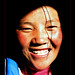 smiling-tibetan-girl-coming-out-dark
