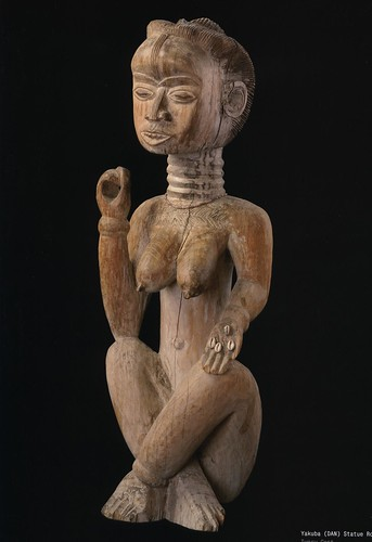 african art, figure sitting woman