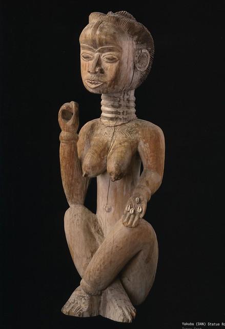 african art, figure sitting woman