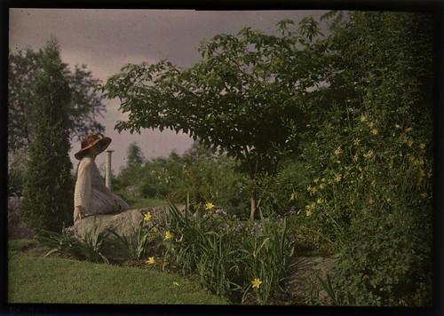 Ethel Dietz Nichols sitting on rock in garden
