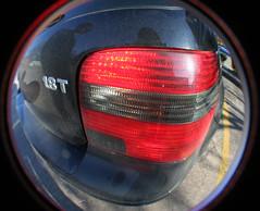 wheel(0.0), rim(0.0), steering wheel(0.0), spoke(0.0), automobile(1.0), automotive tail & brake light(1.0), automotive exterior(1.0), vehicle(1.0), automotive lighting(1.0), red(1.0), automotive design(1.0), light(1.0), bumper(1.0),