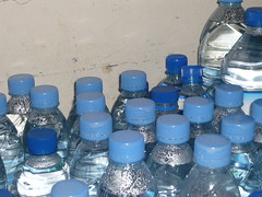 glass bottle(0.0), drinkware(0.0), glass(0.0), drink(0.0), water(1.0), cobalt blue(1.0), bottle(1.0), plastic bottle(1.0), bottled water(1.0), mineral water(1.0), blue(1.0), drinking water(1.0),