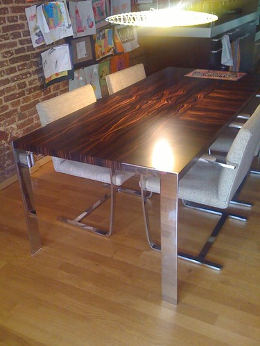 dining table - ebony veneer, polished steel legs