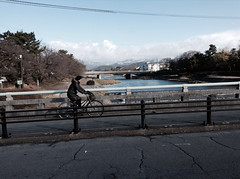 Cycling near Demachiyamagi snow on hills up north