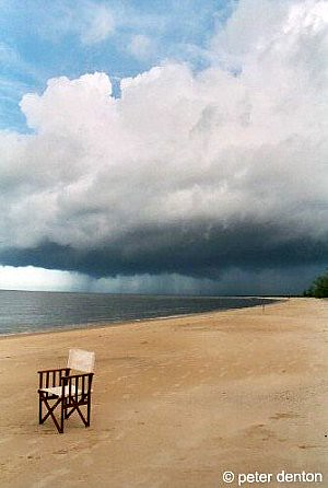 africa beach nature water weather clouds 35mm tanzania sand chair scanned analogue minimalism storms picnik lifeisart saadani bestminimalshot ©peterdenton