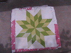 I love this quilt and all its tatteredness!