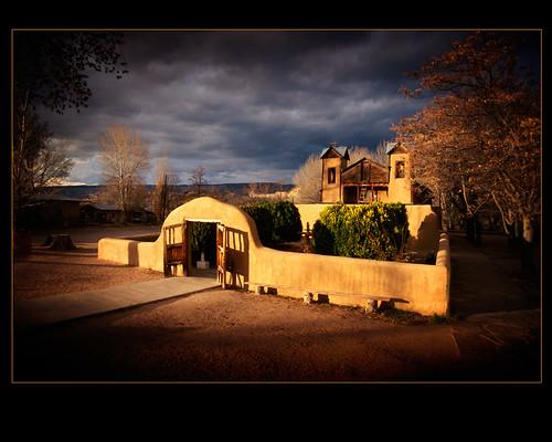 sunset newmexico church easter catholic adobe thunderstorm fujichrome sanctuary springtime chimayo 1812 nikonfa newmexicostatefair adobechurch fujislidefilm sanctuariodechimayo vivitar1935mmlens