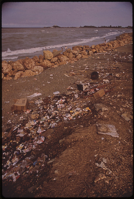 DOCUMERICA: Garbage-Strewn Atlantic Beach 02/1973, Puerto Rico 02/1973 by John Vachon (1914-1975).