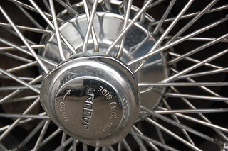 """Old Jaguar E-type sports car: hubcap sprocket text """"UNDO --> RIGHT (OFF) SIDE"""""""