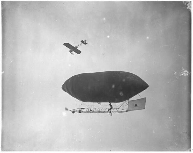Man-powered balloon and monoplane in air at Squantum, Harvard-Boston Aero-meet
