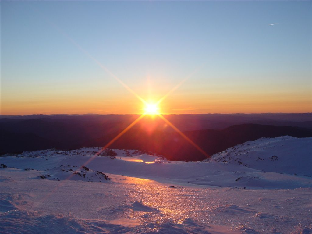 Sunset Over Snowy Mountains
