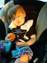 sequoia fell asleep in the car, holding his orange r…