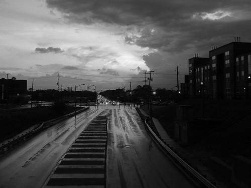 road street sunset sky bw wet rain clouds twilight dusk michigan lansing 2008 blackwhitephotos 2008yip