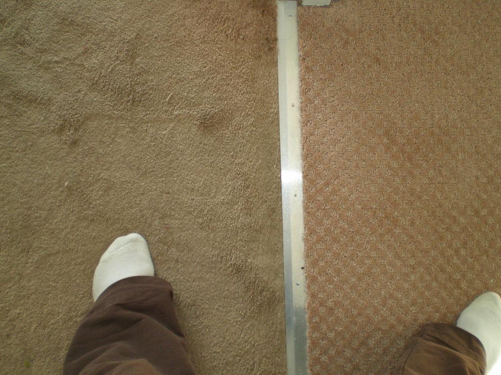 Bedroom carpet next to new carpet