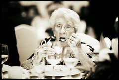 Edward Olive   fotos de boda madrid - creative wedding photography - bride's grandmother eats sorbet ice cream out of cocktail type glass