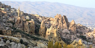Ancient rock houses intermingled with modern houses in Cappadocia, Turkey