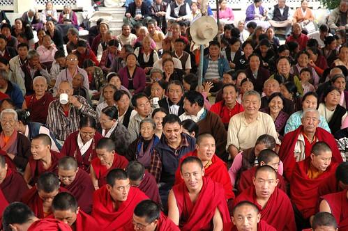 Happy Sangha! Tibetan Buddhists, White hat, Tharlam Monastery Courtyard, Boudha, Kathmandu, Nepal by Wonderlane