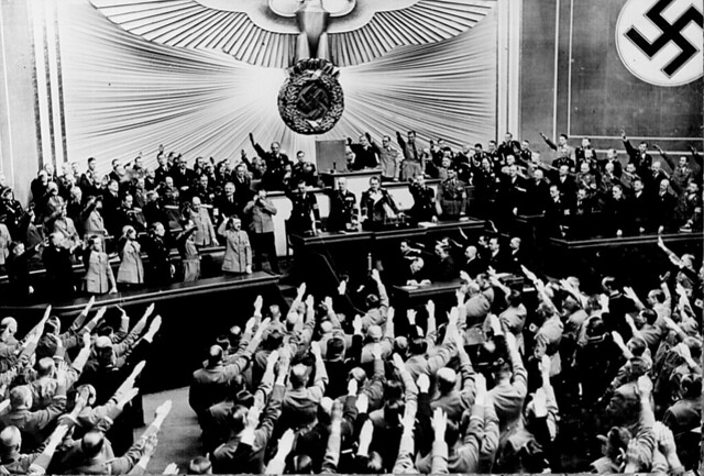 Hitler accepts the ovation of the Reichstag after the Anschluss of Austria in March 1938