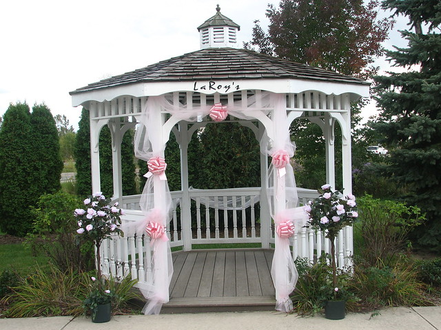 early fall day awaits this gazebo decorated for a wedding which will