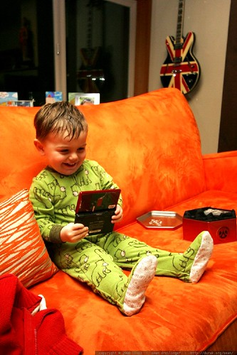 while we were distracted by star wars legos, a little green man snuck onto the couch and opened up the big kid's nintendo DS game    MG 2525