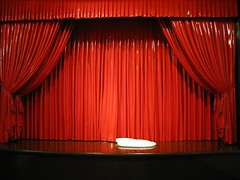 window treatment(0.0), line(0.0), window covering(0.0), window blind(0.0), decor(1.0), textile(1.0), theater curtain(1.0), music venue(1.0), red(1.0), stage(1.0), curtain(1.0), auditorium(1.0), interior design(1.0),