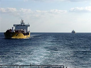 Dutch cargo ships the MV Stolt Innovation, in the foreground, and the MV Stolt Helluland, in the background, seen from the rear of Dutch warship de Ruyter in the Gulf of Aden on Tuesday, Dec. 9, 2008. by Pan-African News Wire File Photos