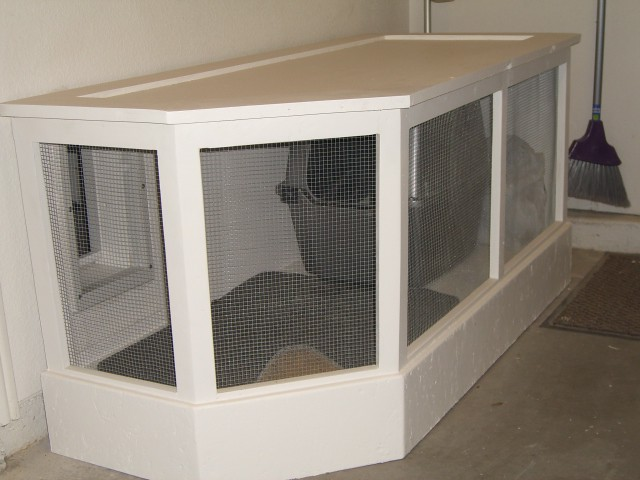 Litter box in garage flickr photo sharing for Dog kennel in garage ideas
