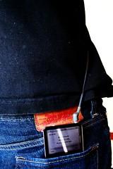 bag(0.0), handbag(0.0), strap(0.0), outerwear(0.0), zipper(0.0), brand(0.0), belt(0.0), denim(1.0), textile(1.0), clothing(1.0), leather(1.0), blue(1.0), black(1.0),